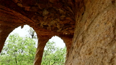 Colonnaded path under roadway viaduct in Antoni Gaudi's Park Guell, Barcelona Stock Footage
