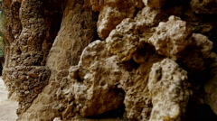 Colonnaded footpath under the roadway viaduct in Gaudi's Park Guell, Barcelona Stock Footage