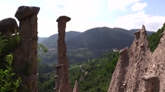 Group of Earth Pyramids over the valley Stock Footage