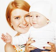Young beauty mother with baby, red head happy family isolated close up Stock Photos
