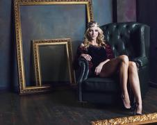 Young blond woman wearing crown in fairy luxury interior with empty antique Kuvituskuvat
