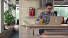 Man works in the coworking with laptop Stock Footage