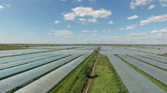 Aerial footage of greenhouses at country side - stock footage