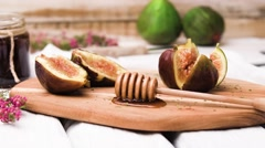 Figs and honey - stock footage