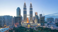 Dramatic day to night to day at Kuala Lumpur city skyline Stock Footage