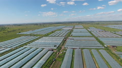 Aerial footage of greenhouses at country side Stock Footage