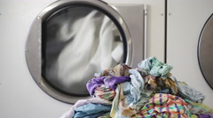 Washing machines in laundry room with rotating drums Stock Footage