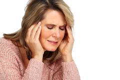 Senior woman having a migraine headache. - stock photo