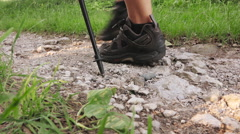 Feet and poles detail of woman doing nordic walking in the park Stock Footage