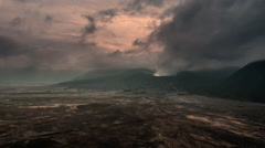 Stormy clouds over craters of volcanoes in national park in Java Stock Footage