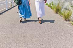 Walking women's feet Stock Photos
