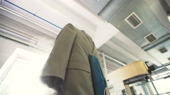 Machine cleaning jacket in a dry-cleaning Stock Footage