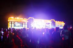 silhouette crowd in front of concert stage blurred - stock photo