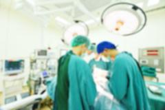 Blur of group of veterinarian surgery in operation room Kuvituskuvat