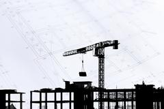 Construction site with cranes on silhouette background Stock Photos