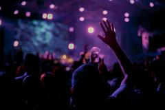 Crowd in front of concert stage blurred - stock photo