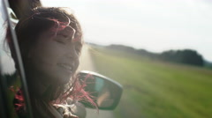 Little girl leaning out of car window. Close up Arkistovideo