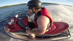 Seadoo rider racing around the lake Stock Footage