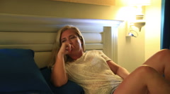 Thoughful crying woman  on a bed Stock Footage