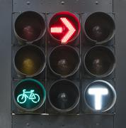 Traffic lights for bicycles, cars and trams - stock photo