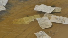 Paper is Floating by the River or Lake Manuscript is Thrown Into the Water Stock Footage