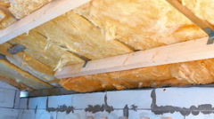 Man Insulating Roof With Fiberglass (Glasswool) Stock Footage