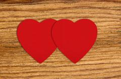 Red felt hearts on wooden background Stock Photos