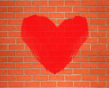 Red heart painted on orange brick wall background - stock photo