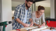 Couple assembling new furniture - stock footage