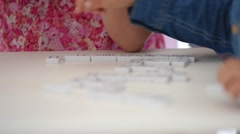 Closeup of kids playing dominos Stock Footage