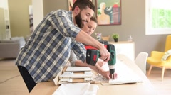 Couple assembling new furniture Stock Footage
