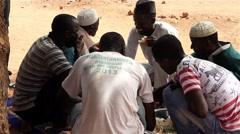 Africa native village men eating - Mandingo ethnic group Stock Footage