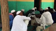Africa native village men eating - Balanta ethnic group Stock Footage