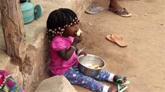 Native village girl eating - Mandingo ethnic group Stock Footage