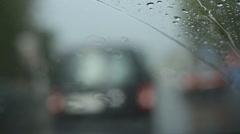 Rainy traffic. Looking through windshield at defocused traffic. heavy rain Stock Footage