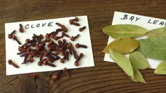 Various spices on old brown wooden table Stock Footage