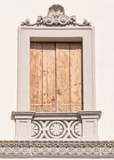 Decorated window of an Italian neoclassical villa. Stock Photos
