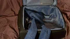 Scared Woman Packing A Suitcase In A Hurry, She's Panicking, Hand Held Camera Stock Footage