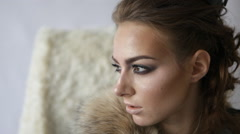 close-up portrait of thoughtful model with crown looking at camera and posing - stock footage