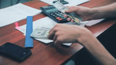 Man hands counting profit . US dollars Stock Footage