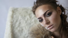 Close-up portrait of fashion model with crown looking at the camera and posing Stock Footage