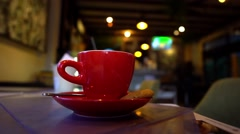 Coffee. Cup of Hot Coffee Cappucchino. Dark cafe. Red Cup of hot beverage with Stock Footage
