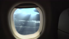 Sun rays in the clouds from an airplane window. Stock Footage