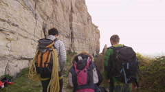 4K Group of rock climbers hiking to location to begin a climb.  Stock Footage