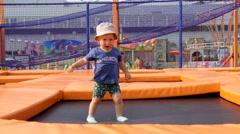 a Child Runs on Children's Soft Trampoline - stock footage