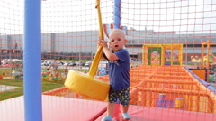 Little Boy Playing in the Children's Maze - stock footage
