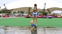 Mom Plays With the Child in a Pool, Holding Hands and Circling - stock footage