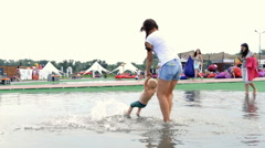 Mom Plays With the Child in a Pool - stock footage
