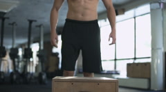 Guy doing exercise with a fit box in a gym Stock Footage