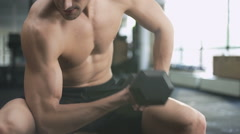 Man workout with dumbbells in gym - stock footage